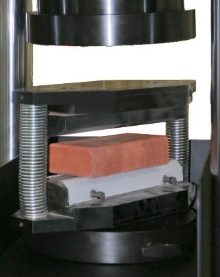 Indirect tensile testing device for pavers