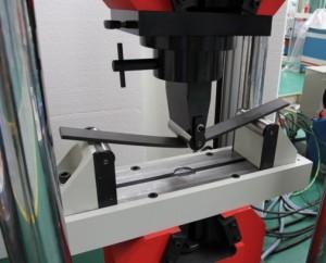 Puente de flexión y plegado diseñado para conexión directa a cabezal máquina de ensayos.